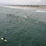 Surfers Paddling Out in Huntington Beach